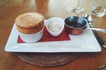 Praline soufflé with banana toffee ice cream and caramel sauce